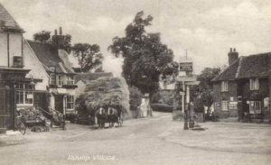 Ruislip Village Postcard - looking towards Sharps Lane from the mini-roundabout. That's Prezzo on the right.